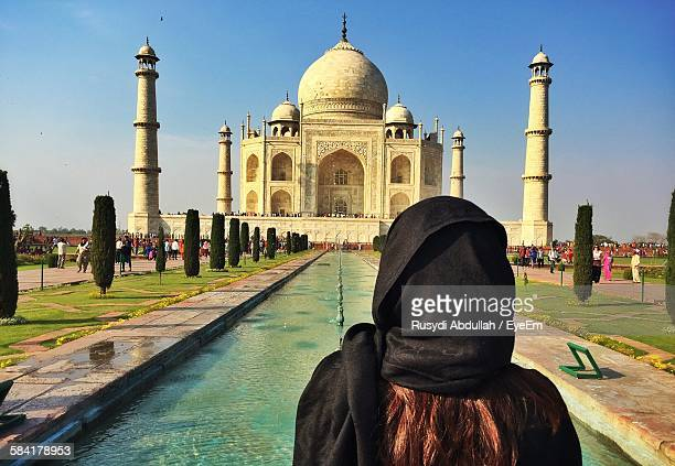 Rear View Of Woman Looking At Taj Mahal