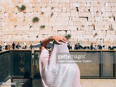 Rear View Of Woman Looking At The Mens Section Of The Western Wall