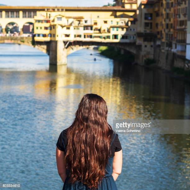 Rear View Of Woman Looking At View Of Ponte Vecchio