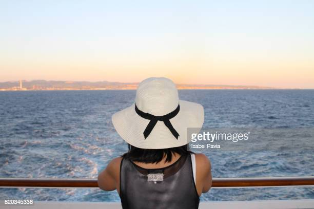 Rear View Of Woman On Holidays On Cruise Ship