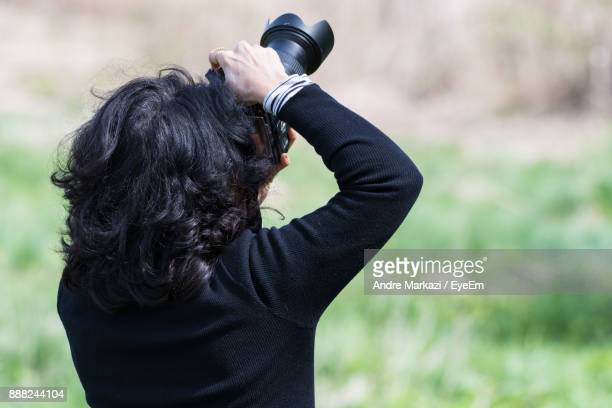 Rear View Of Woman Photographing With Camera