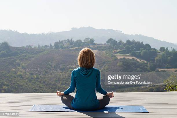 Rear view of woman practicing yoga