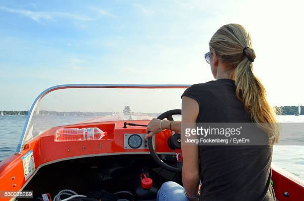 Rear View Of Woman Sailing Boat Is Sea