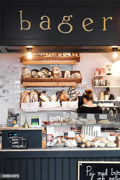 Rear view of woman standing at cafe counter