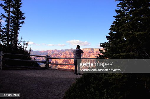 Rear View Of Woman Standing By Railing Against Cedar Breaks National Monument