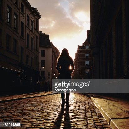 Rear view of woman standing in street