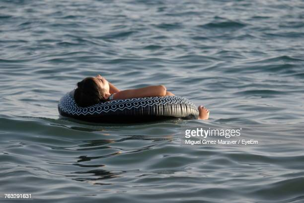 Rear View Of Woman Swimming In Sea