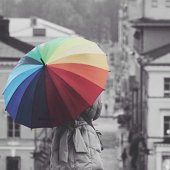 Rear view of woman under colorful umbrella