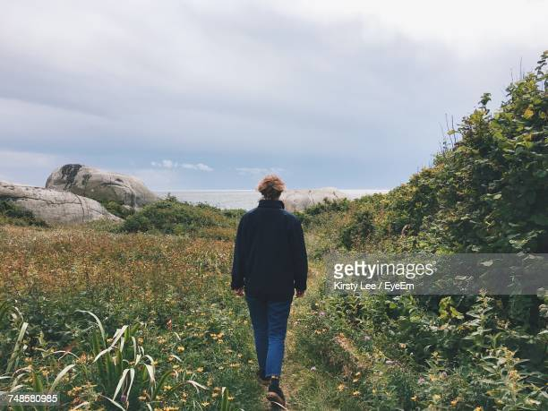 Rear View Of Woman Walking In Nature In Norway