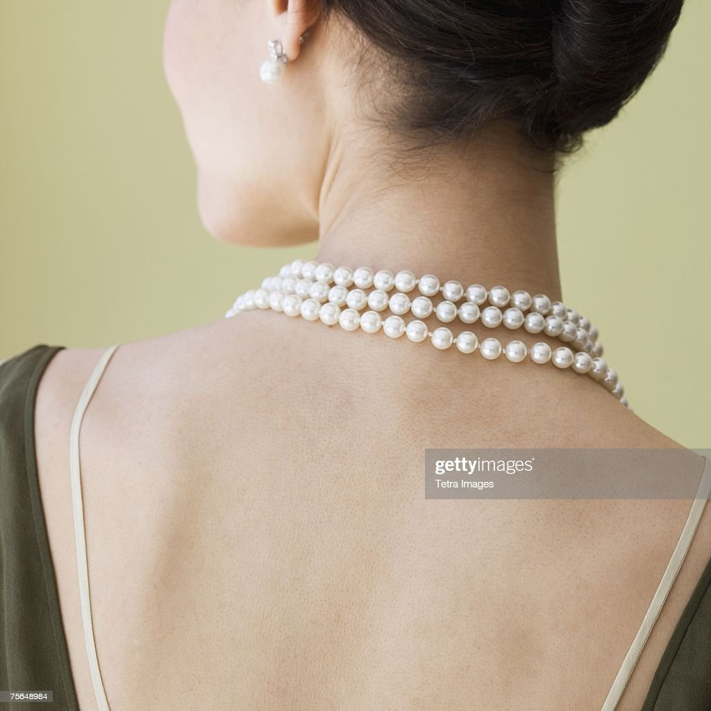 Rear view of woman wearing pearl necklace