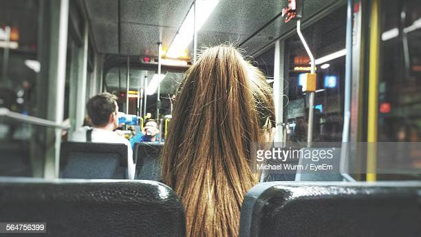 Rear View Of Woman With Blond Ponytail Traveling In Bus