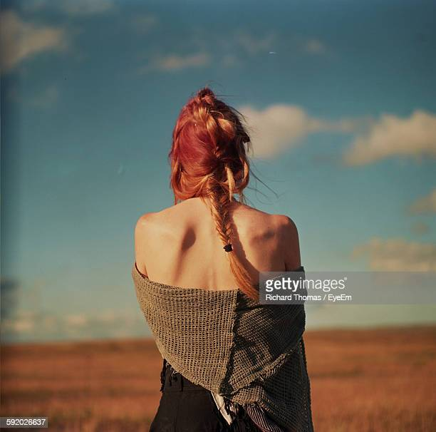 Rear View Of Woman With Braided Hair Standing On Field