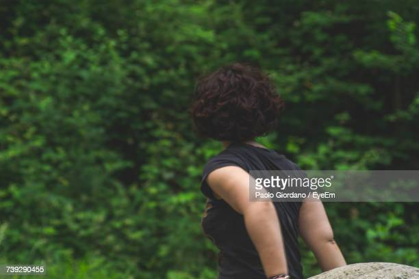 Rear View Of Woman With Short Hair Standing Against Tree