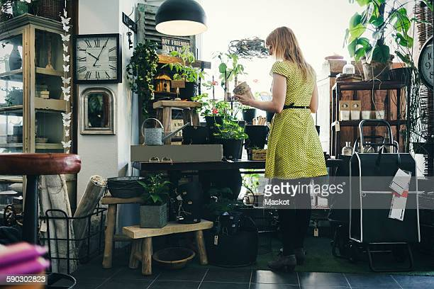 Rear view of woman working in interior design shop