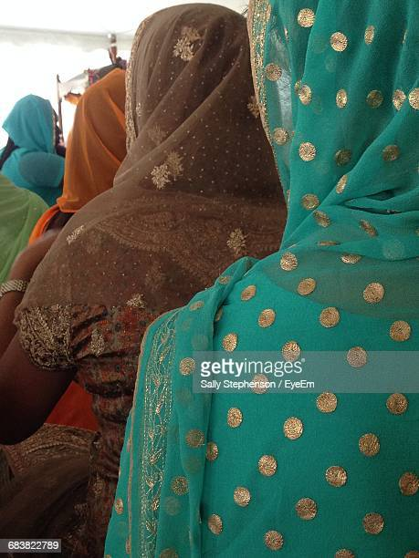 Rear View Of Women Sitting At Wedding