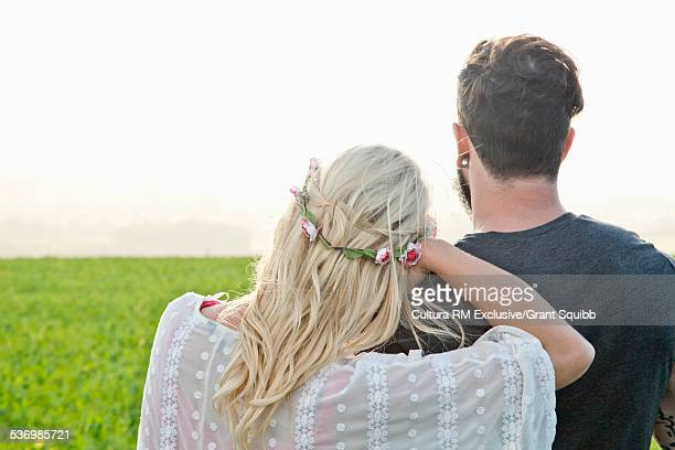 Rear view of young couple in rural field