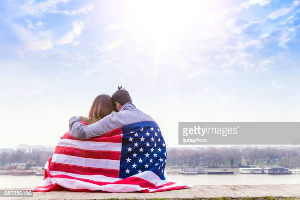 Rear view of Young couple with American flag