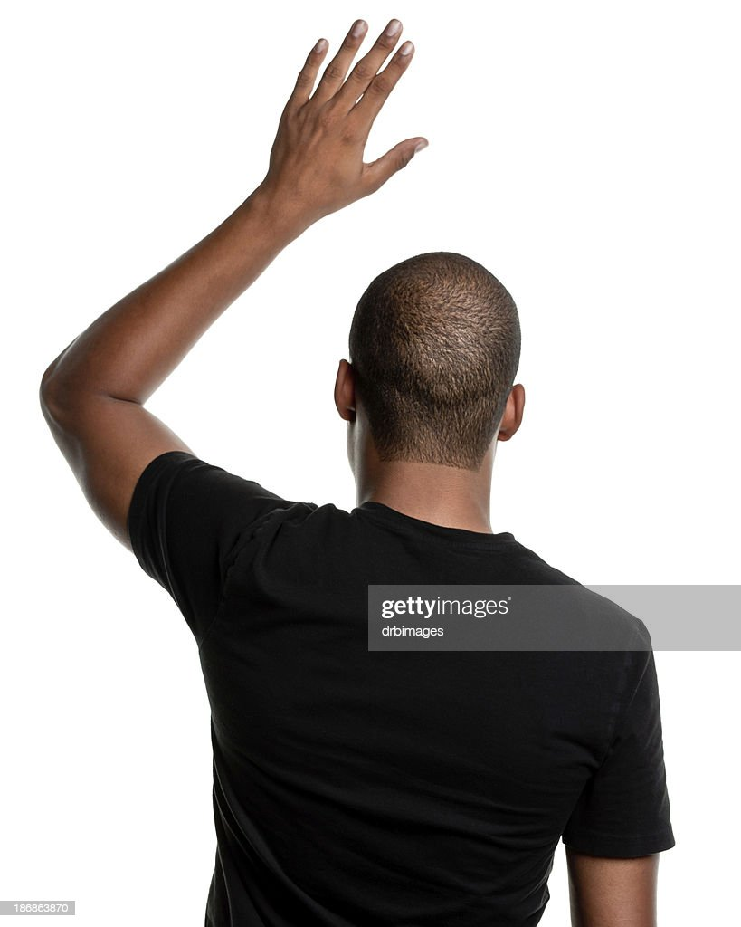 'Rear View of Young Man, Hand Raised Asking Question'