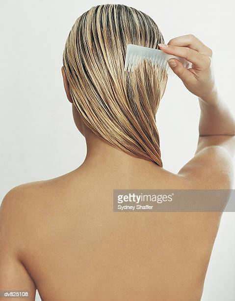 Rear View of Young Woman Brushing Her Hair