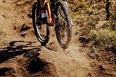 rear wheel sport bike rides on earth dust