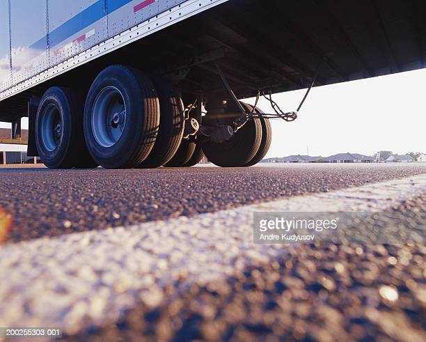 Rear wheels of semi truck, low angle view