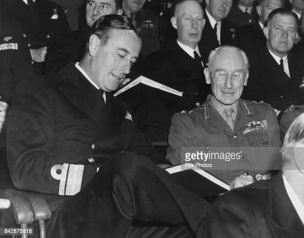 RearAdmiral Louis Mountbatten and LieutenantGeneral Evelyn Barker General Officer CommandinginChief Eastern Command review the programme of events at...