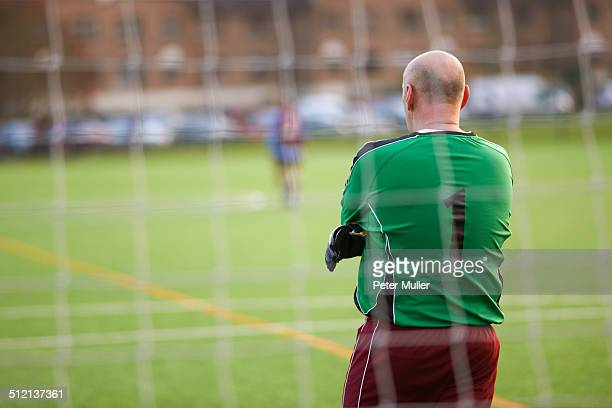 Rearview of goalie at football game
