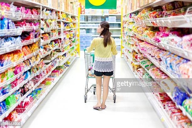 Rear-view of woman shopping in grocery store
