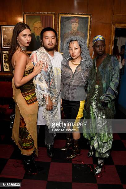 Reba Maybury A Sai Ta guest and Aweng attend the Fashion East London Fashion Week party in association with Bumble at Moth Club on September 17 2017...