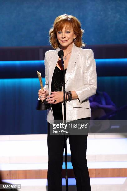 Reba McEntire accepts the Mae Boren Axton Award onstage during the 11th Annual ACM Honors at the Ryman Auditorium on August 23 2017 in Nashville...