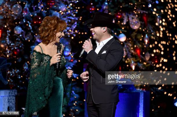 Reba McEntire and Dustin Lynch perform onstage for CMA 2017 Country Christmas at The Grand Ole Opry on November 14 2017 in Nashville Tennessee