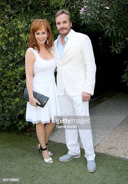Reba McEntire and Narvel Blackstock attend a private sunset reception at Minerva Beach celebrating Fight Night In Italy benefitting The Andrea...
