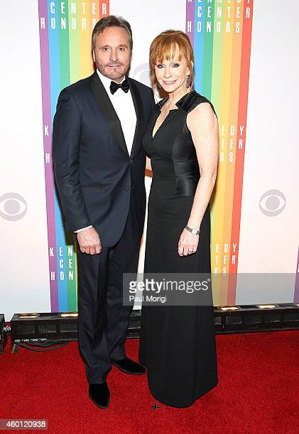 Reba McEntire and Narvel Blackstock pose for photos on the red carpet at the 37th Annual Kennedy Center Honors at the John F Kennedy Center for the...
