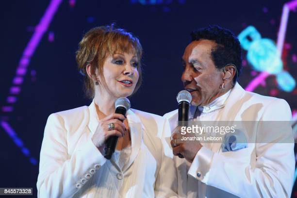 Reba McEntire and Smokey Robinson perform during the Closing Night Gala at Cinecittà as part of the 2017 Celebrity Fight Night in Italy Benefiting...