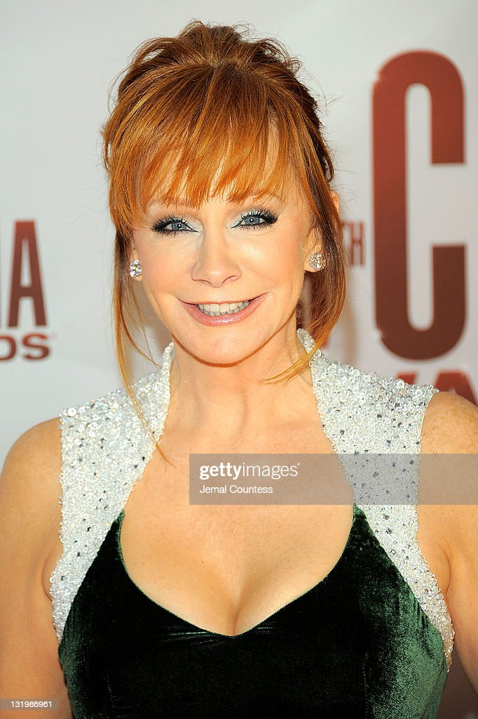 <a gi-track='captionPersonalityLinkClicked' href=/galleries/search?phrase=Reba+McEntire&family=editorial&specificpeople=202959 ng-click='$event.stopPropagation()'>Reba McEntire</a> attends the 45th annual CMA Awards at the Bridgestone Arena on November 9, 2011 in Nashville, Tennessee.