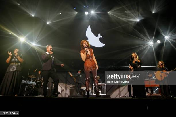 Reba McEntire Joseph Habedank Tasha Cobbs Leonard and Erica Campbell perform during the 48th Annual GMA Dove Awards in Allen Arena on October 17 2017...