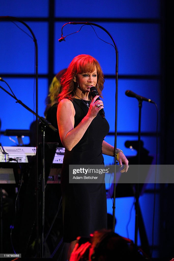 <a gi-track='captionPersonalityLinkClicked' href=/galleries/search?phrase=Reba+McEntire&family=editorial&specificpeople=202959 ng-click='$event.stopPropagation()'>Reba McEntire</a> performs at the Starkey Hearing Foundation's 'So The World May Hear Awards Gala' 2011 at River Centre on July 24, 2011 in St. Paul, Minnesota.