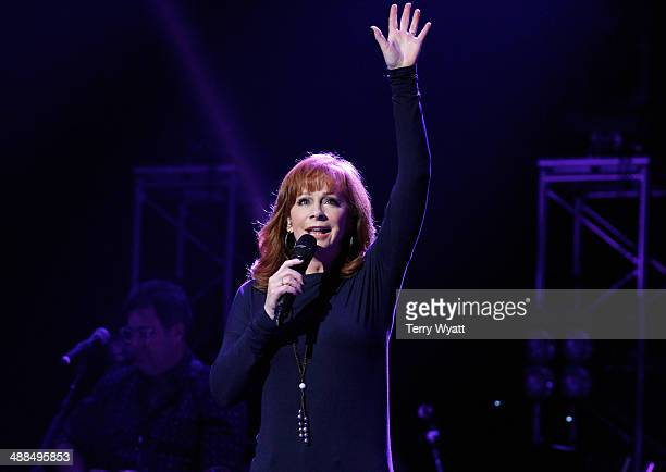 Reba McEntire performs on stage during Keith Urban's Fifth Annual 'We're All 4 The Hall' Benefit Concert at the Bridgestone Arena on May 6 2014 in...
