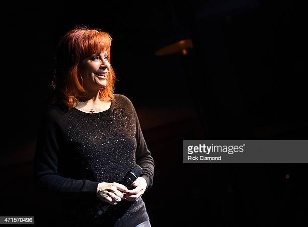Reba McEntire performs onstage at a private concert for SiriusXM listeners at The Loveless Barn on April 29 2015 in Nashville Tennessee