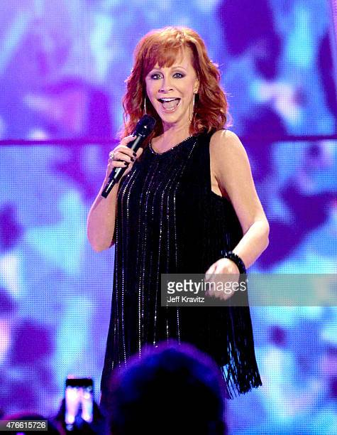 Reba McEntire performs onstage at the 2015 CMT Music awards at the Bridgestone Arena on June 10 2015 in Nashville Tennessee