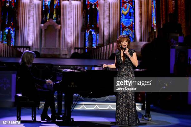 Reba McEntire performs onstage for CMA 2017 Country Christmas at The Grand Ole Opry on November 14 2017 in Nashville Tennessee