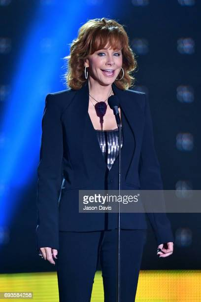 Reba McEntire presents an award onstage from at the 2017 CMT Music Awards at the Music City Center on June 7 2017 in Nashville Tennessee