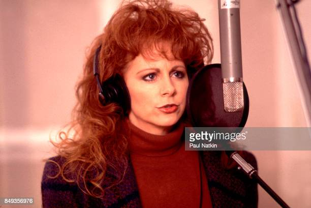Reba McEntire recording her vocal part before a video shoot for the song Amazing Grace for the soundtrack of the film 'Maverick' at Amy Grant's farm...