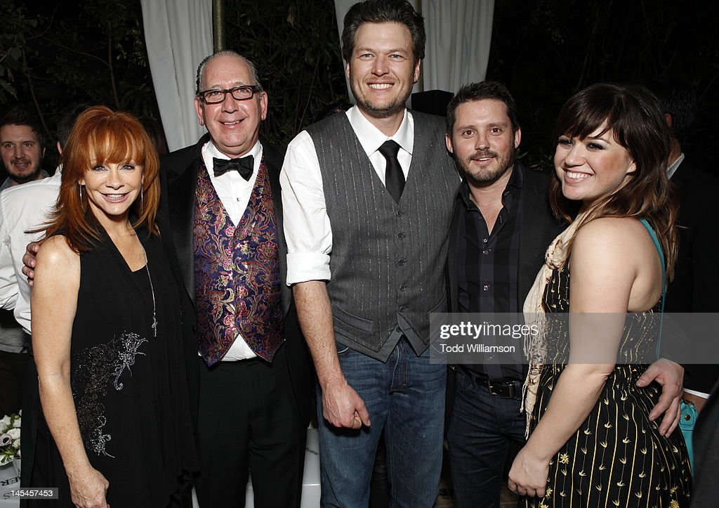 <a gi-track='captionPersonalityLinkClicked' href=/galleries/search?phrase=Reba+McEntire&family=editorial&specificpeople=202959 ng-click='$event.stopPropagation()'>Reba McEntire</a>, Warner Music Nashville's President and CEO John Espositio, <a gi-track='captionPersonalityLinkClicked' href=/galleries/search?phrase=Blake+Shelton&family=editorial&specificpeople=2352026 ng-click='$event.stopPropagation()'>Blake Shelton</a>, Brandon Blackstock and <a gi-track='captionPersonalityLinkClicked' href=/galleries/search?phrase=Kelly+Clarkson&family=editorial&specificpeople=201555 ng-click='$event.stopPropagation()'>Kelly Clarkson</a> attend Warner Music Group Grammy Celebration hosted by InStyle at Chateau Marmont on February 12, 2012 in Los Angeles, California.