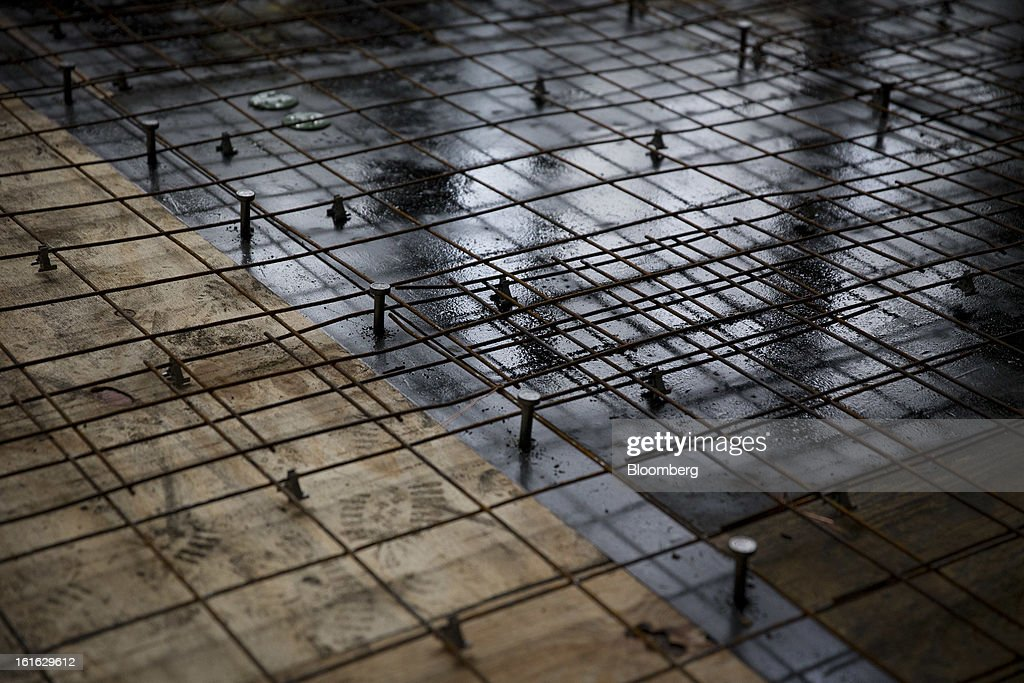 Rebar is set down to reinforce a concrete floor, not yet laid, for a modular housing unit on the Capsys Corp. factory floor at the Brooklyn Navy Yard in the Brooklyn borough of New York, U.S., on Wednesday, Feb. 13, 2013. Capsys Corp., which specializes in prefabricated buildings, will be building micro-unit apartments in New York City. Photographer Scott Eells/Bloomberg via Getty Images