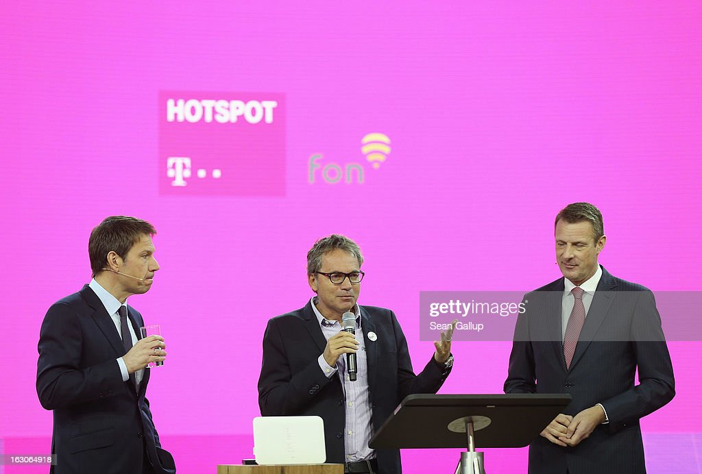 Rebe Obermann (L), CEO of Deutsche Telekom, Martin Varsavsky (C), CEO and founder of FON, and Deutsche Telekom COO Niek Jan van Damme present Deutsche Telekom's new partnership with FON to operate 2.5 million WLAN hotspots in Germany by 2016 at the Deutsche Telekom stand at the 2013 CeBIT technology trade fair on March 4, 2013 in Hanover, Germany. CeBIT will be open March 5-9.