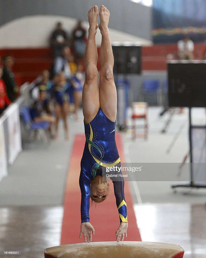 Rebeca Rodrigues De Andrade of Brazil competes during the Women's Team all-around as part of the I ODESUR South American Youth Games at Coliseo Miguel Grau on September 23, 2013 in Lima, Peru.