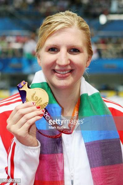 Rebecca Adlington of England poses with the gold medal during the medal ceremony for the Women's 400m Freestyle Final at Dr SP Mukherjee Aquatics...