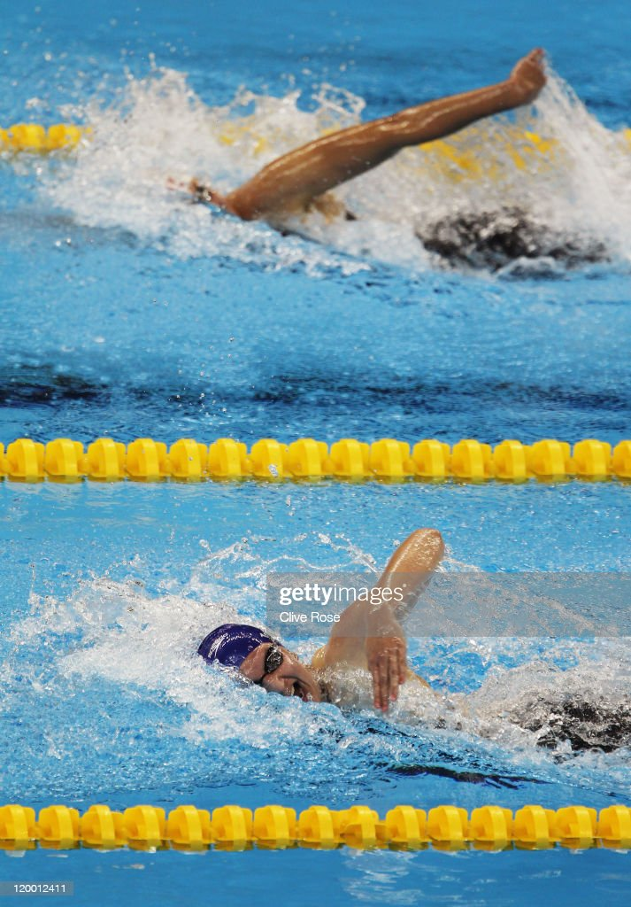 Rebecca Adlington of Great Britain and Lotte Friis of Denmark compete in heat five of the Women's 800m Freestyle heats during Day Fourteen of the...