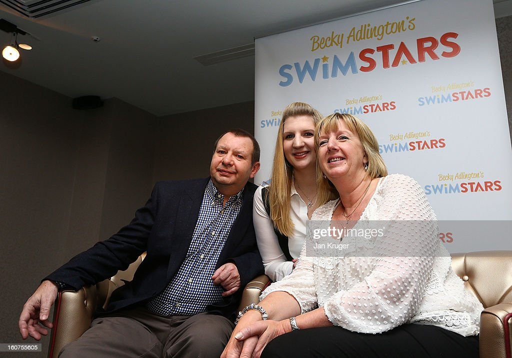 Rebecca Adlington poses with her mother Kay and father Steve during a press conference as she announces her retirement from swimming, at InterContinental London Westminster Hotel on February 5, 2013 in London, England.